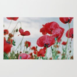 Field of Poppies Against Grey Sky Rug