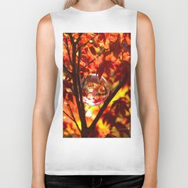 Red autumn foliage in the world of a globe Biker Tank