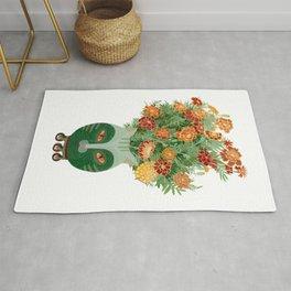 Marigolds in cat face vase  Rug