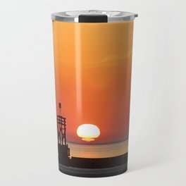 Sinking into the sea Travel Mug