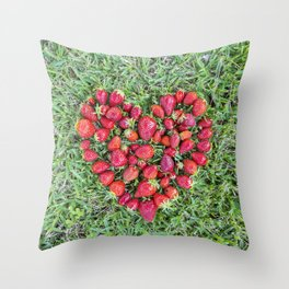 Heart made of strawberries with grass in the background Throw Pillow