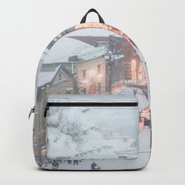 Blizzard in town Backpack