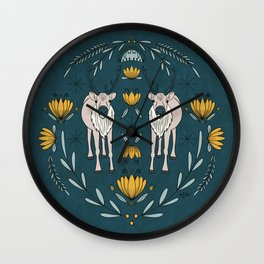 Reindeer Circular Folk Art Illustration Featuring Arctic Wildflowers In Autumn Jewel Tones Teal Aqua and Mustard Wall Clock