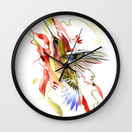 Flying Hummingbird and red tropical foliage Wall Clock