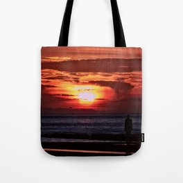 As the Sun goes down Tote Bag