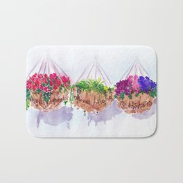 Brightly coloured flowers hanging in my baskets | By Sarah Cannon Bath Mat