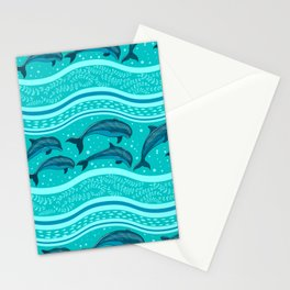 A flock of dolphins in the sea, strips and borders. Marine seamless pattern. Stationery Cards