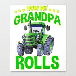 Farmer grandson drives trekker Canvas Print