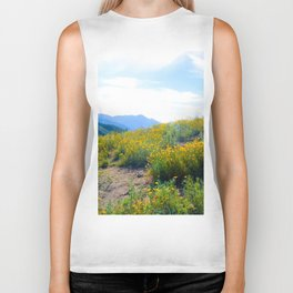 yellow poppy flower field with green leaf and blue cloudy sky in summer Biker Tank
