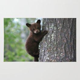 Bear Cub Climbing a Tree Rug