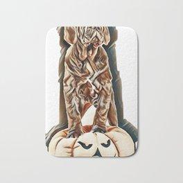 Italian mastiff cane corso on toy pumpkin to Halloween on white background        - Image Bath Mat