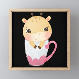 Cute giraffe looks out of a cup with stars Framed Mini Art Print