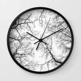 Black branches, white sky Wall Clock