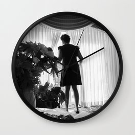 Woman Looking through the Window, A Wall Clock