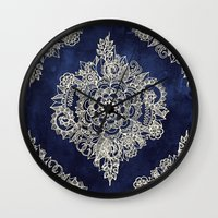 royal tenenbaums Wall Clocks featuring Cream Floral Moroccan Pattern on Deep Indigo Ink by micklyn