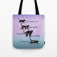 marx Tote Bags featuring Black cat crossing by IvanaW
