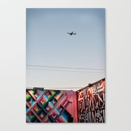 Plane in night sky Canvas Print