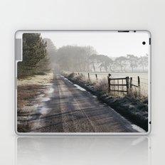 Remote frozen country road a t sunrise. Norfolk, UK. Laptop & iPad Skin