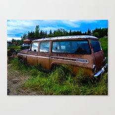Old car resting in a field Canvas Print