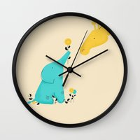 baby elephant Wall Clocks featuring Baby Elephant by Jay Fleck