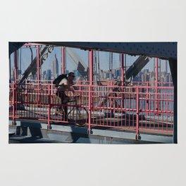 Cyclist on Williamsburg Bridge Rug
