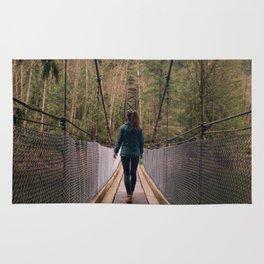 suspension bridge through the trees Rug