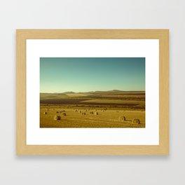 Farm field with hay bales Framed Art Print