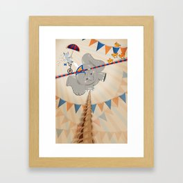 Elephant on tightrope Framed Art Print