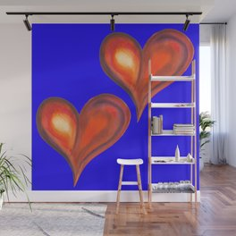Two watercolor hearts isolated on blue background. Wall Mural