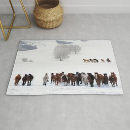 Horses running on the snow Rug