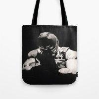 bane Tote Bags featuring Bane by a vitruvian man