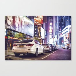 Nighttime in Times Square features with car parking city lights in New York City Canvas Print