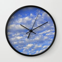 Lots of tiny clouds. Wall Clock