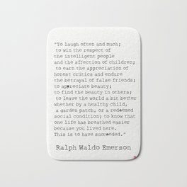 """To laugh often and much;"" Ralph Waldo Emerson quote Bath Mat"