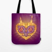majora Tote Bags featuring Steampunk Majora by Evan Ayres