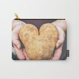 Hands holding a heart shaped raw potato full of dirt Carry-All Pouch