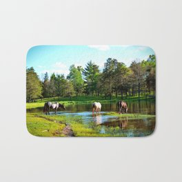The watering hole Bath Mat