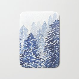 A snowy pine forest Bath Mat