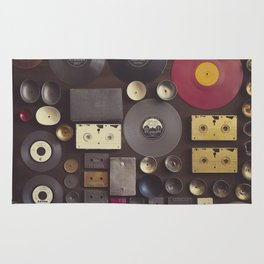 Music. Vintage wall with vinyl records and audio cassettes hung. Rug
