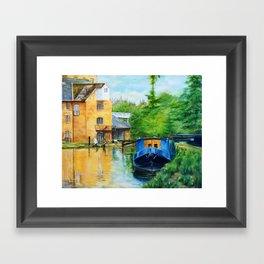 A narrow boat stops after passing through Coxes Lock near Addlestone in Surrey.  Framed Art Print