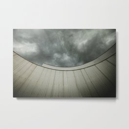 Building with metal covering against stormy sky Metal Print