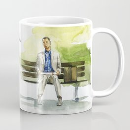 Forrest Gump (Tom Hanks) sitting on a bench with a flying feather Coffee Mug