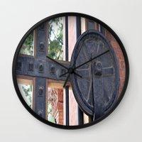 metal gear Wall Clocks featuring Metal Gear by Photaugraffiti