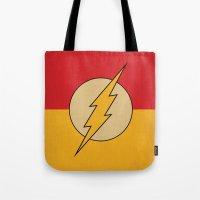 dc comics Tote Bags featuring Flash Logo Minimalist Art Print DC Comics by The Retro Inc