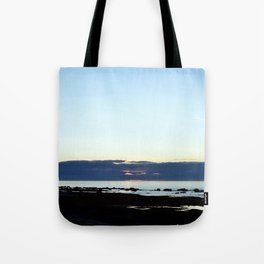 Mean faced cloud hides the Sunset Tote Bag