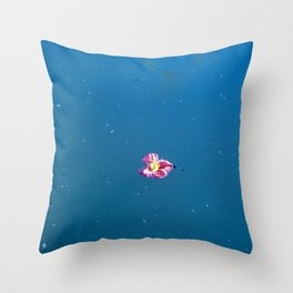 A pink blossom floating in a contrast blue lake Throw Pillow