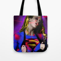 supergirl Tote Bags featuring Supergirl by EarlyHuman