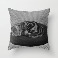 sofa Throw Pillows featuring sleeping cat on sofa by gzm_guvenc