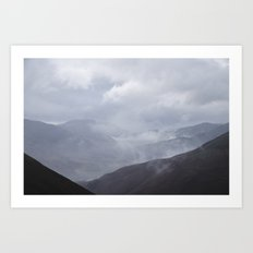 Rain clouds rolling through the mountains. Cumbria, UK. Art Print