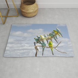 Parakeets perched on a limb Rug